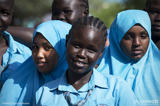 Esther Nyakong, 17, (center) smiles with other students at the Morneau Shepell Girls School in Kakuma.